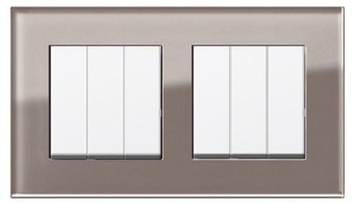 Două întrerupătoare triple GIRA Esprit alb lucios cu ramă dublă sticlă umbră