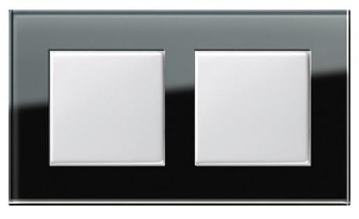 Două întrerupătoare simple GIRA Esprit alb lucios cu ramă dublă sticlă neagră