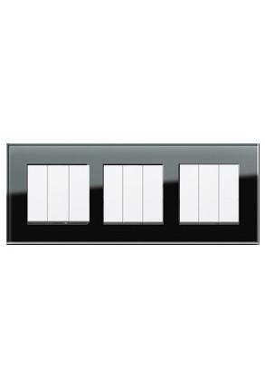 Trei întrerupatoare triple GIRA alb lucios cu ramă triplă sticlă neagră